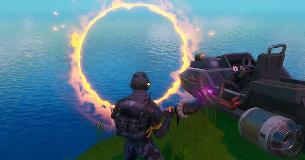 モーターボートでジャンプして複数の炎の輪をくぐり抜ける